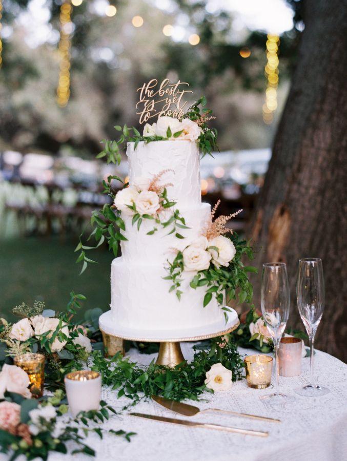 Beautiful greenery topped wedding cake: http://www.stylemepretty.com/2017/05/10/saddlerock-ranch-malibu-wedding/ Photography: Valentina Glidden - http://valentinaglidden.com/