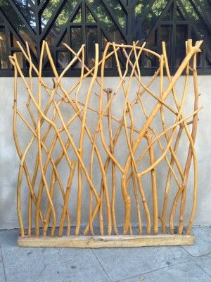 I've got to figure out how to make something like this.  It could act like a room divider/screen, a backdrop, a weaving provocation, it might be fun to weave with lights...I love it!!!