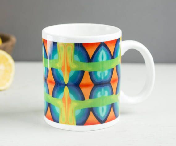 Multicolour mug bright cheerful mug parrot colours by DoodlePippin