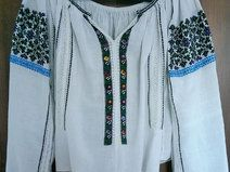 """Beautiful antique romanian traditional top blouse hand embroidered and hand sewn with multicolored cotton thread on homespun traditional fabric. This blouse is very old, is about 70 years old and the embroidery is perfectly preserved.  Is in very good vintage condition for it's age , still very beautiful.  We encourage you to ask all of your questions before purchasing any product.  Measurements:  Length (neckline to hem): 19""""  Sleeve (neck to hem) : 25"""""""