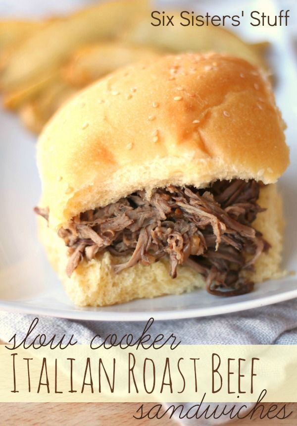 Slow Cooker Italian Roast Beef Sandwiches from SixSistersStuff.com.   Only 4 ingredients to make this delicious meal! #recipes #beef