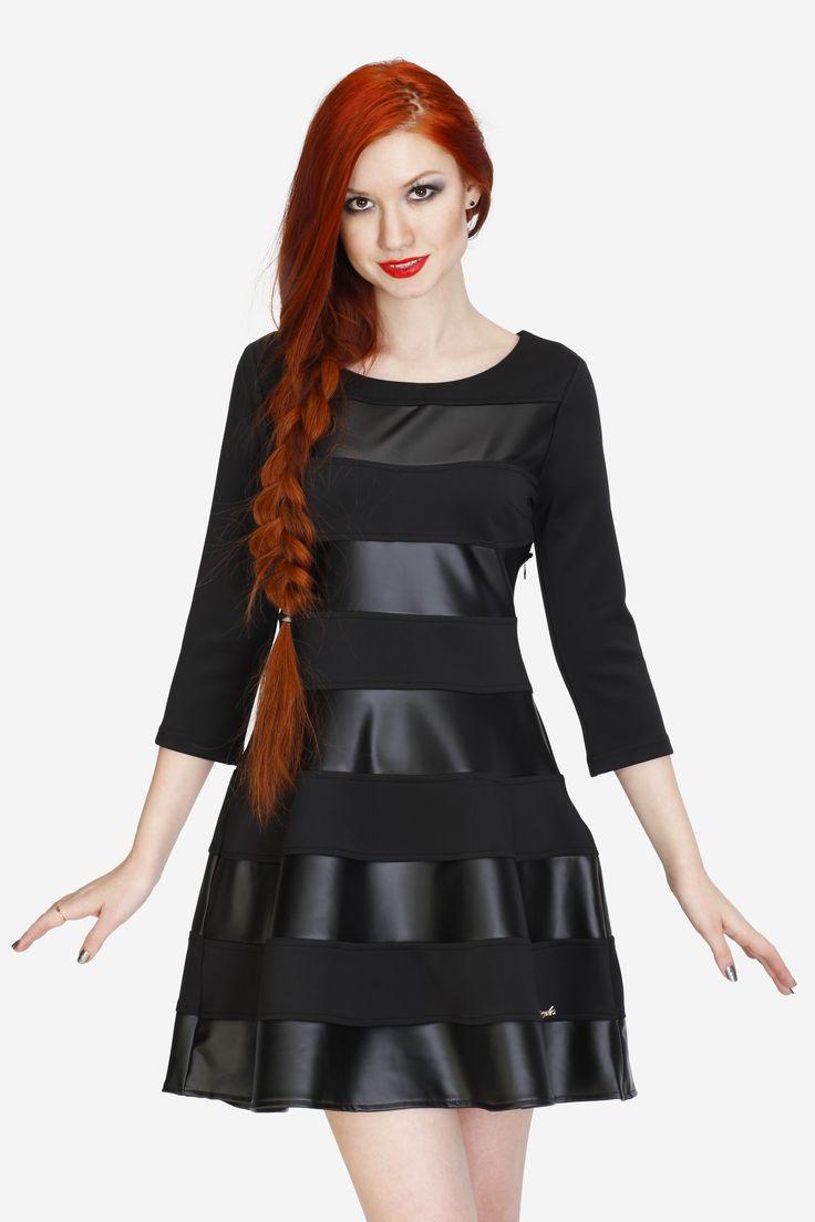 """Платье CICLO. Артикул 010-010-0012. Размеры 38, 40. Элегантное чёрное платье с юбкой-полусолнце. Замеры для размера 36: Длина изделия: выше колена (81 см). Длина рукава: 3/4 (42 см). Вид застёжки: молния слева сбоку. Примечания: Ткань мягкая плотная, полоски равной ширины из матовой ткани скомбинированы с тканью """"под кожу"""". Без подкладки. Фурнитура: брошь в виде значка бренда на подоле. Силуэт платья: верх по фигуре, подол - полусолнце. Стоимость 4500 руб."""