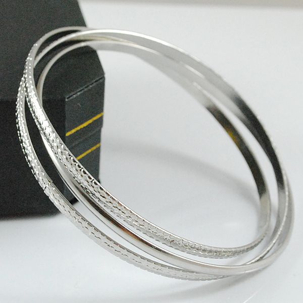 Vintage style - Three Bangles interlinked, 1 plain and 2 patterned - cool summer accessory http://lily316.com.au/shop/banglescuffs/ladies-stainless-steel-triple-linked-bangles/