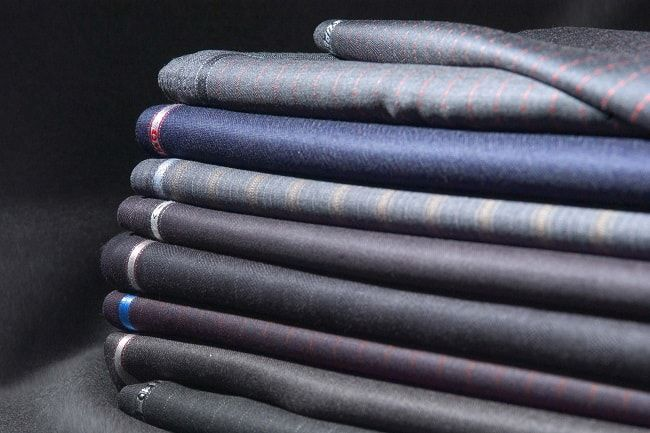 We talk about Fabric Selection, Good Tailors, Prioritising Pleats, and Pocket Squares in this guide on How To Elevate a High Street Suit.