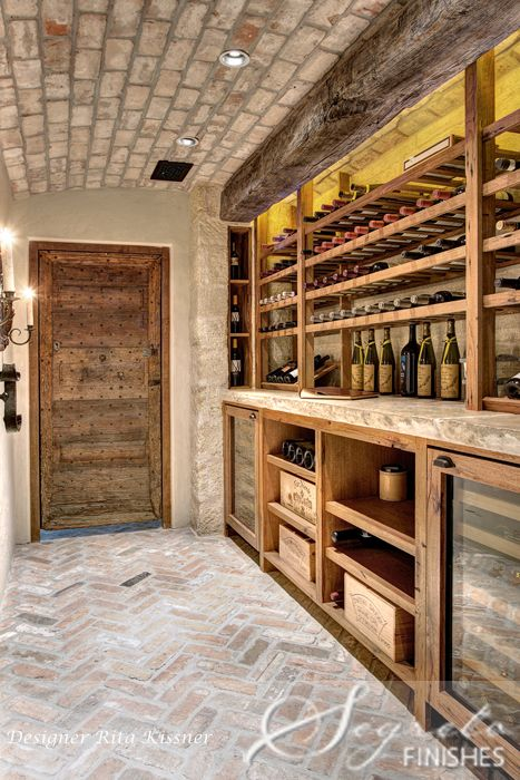 loving this wine room w/ its antique stone counters, antique wood, plaster walls, brick floor and ceiling