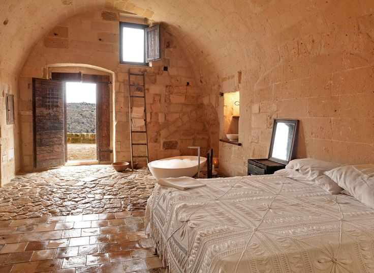 Sextantio Le Grotte della Civita, MATERA Italy  prehistoric - What now makes up the luxe hotel are remnants of 1 of the oldest Neolithic settlements in Italy, a remote cliffside collection of limestone caves that sit on the fringe of Matera.