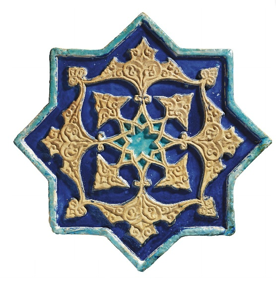 A MOULDED TIMURID STAR-SHAPED TILE IRAN, SECOND HALF 15TH CENTURY The ground deeply carved and glazed cobalt-blue with turquoise in the centre leaving an unglazed central star issuing alternating panels of small and larger bold arabesque designs, the raised design further intricately carved with scrolling motifs with slightly raised turquoise border, intact 17¾in. (45.2cm.) across