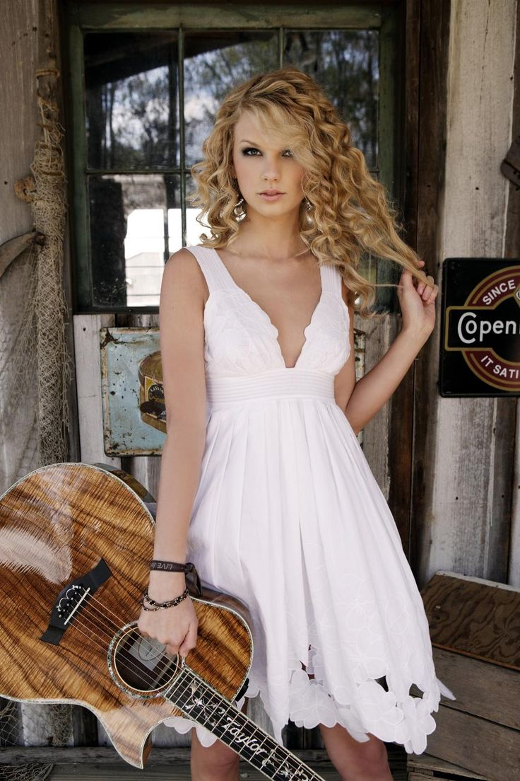 I love T. Swift's new look, but I miss her original country girl swagger.  This dress is perfect.