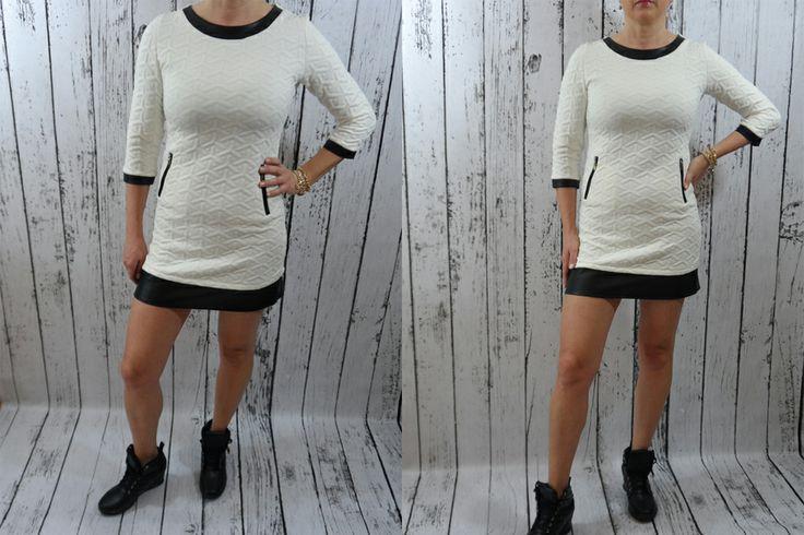 Sukienka mini, miękki, pięknie pikowany materiał. Stylowe wykończenia z eko skóry nadają sukni pazura i podkreślają zgrabność nóg. Eleganckie srebrne suwaki po bokach dodają elegancji, rękaw 3/4. Obszycia z eko skórki, długość mini, zapinana z tyłu na modny suwak ZIP. Rozmiar z metki: S pasuje na osobę w rozmiarze S/M/L - materiał naciąga się!