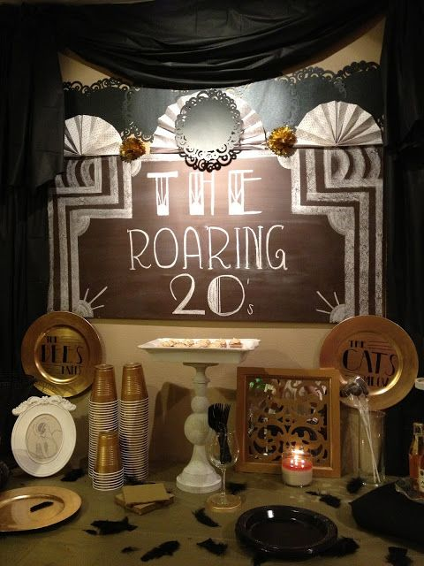 chalkboard/poster board sign, gold plates, $1 tablecloths, feathers, doilies, vintage photo booth sign