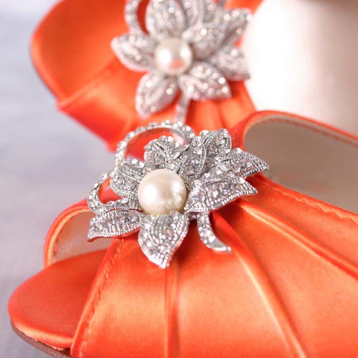A personal favorite from my Etsy shop https://www.etsy.com/listing/258758706/orange-wedding-shoes-kitten-heel-wedding