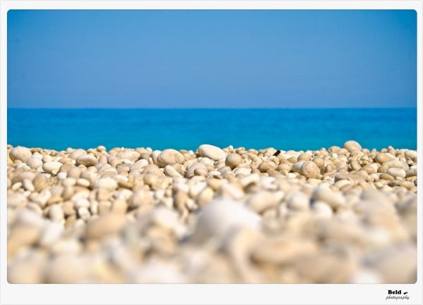 White stones leading to blue sea