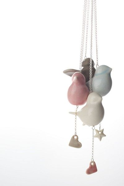 Love this idea for a baby mobile or chandelier. Love the colors. Bird necklace   Glazed porcelain bird with star or heart on a 70 cm silver chain   Bird is approximately 4.5 cm long   Available in baby blue, grey, white or pink with white star, grey heart or pink heart