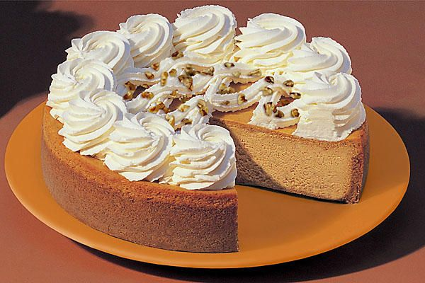 Cheescake Factory pumpkin cheesecake recipe showing whole cake on plate
