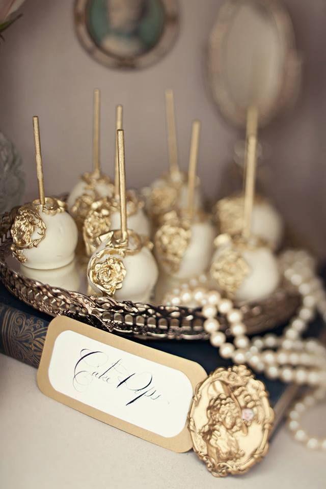 Beautifully designed gold & ivory cake pops<3