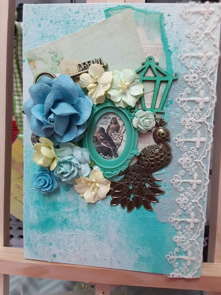Small canvas using items from craft box resin frame, lace, flowers, metal charms.