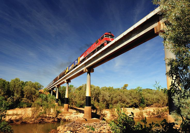 The Ghan crosses the high bridge over the Katherine River in Australia's Northern Territory. Image by Paul White/ ImageBrief.
