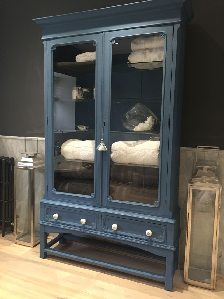 Upcycled painted oak cabinet, new glass, paint, knobs and shelves. Paint colour fired earth Mariana blue.