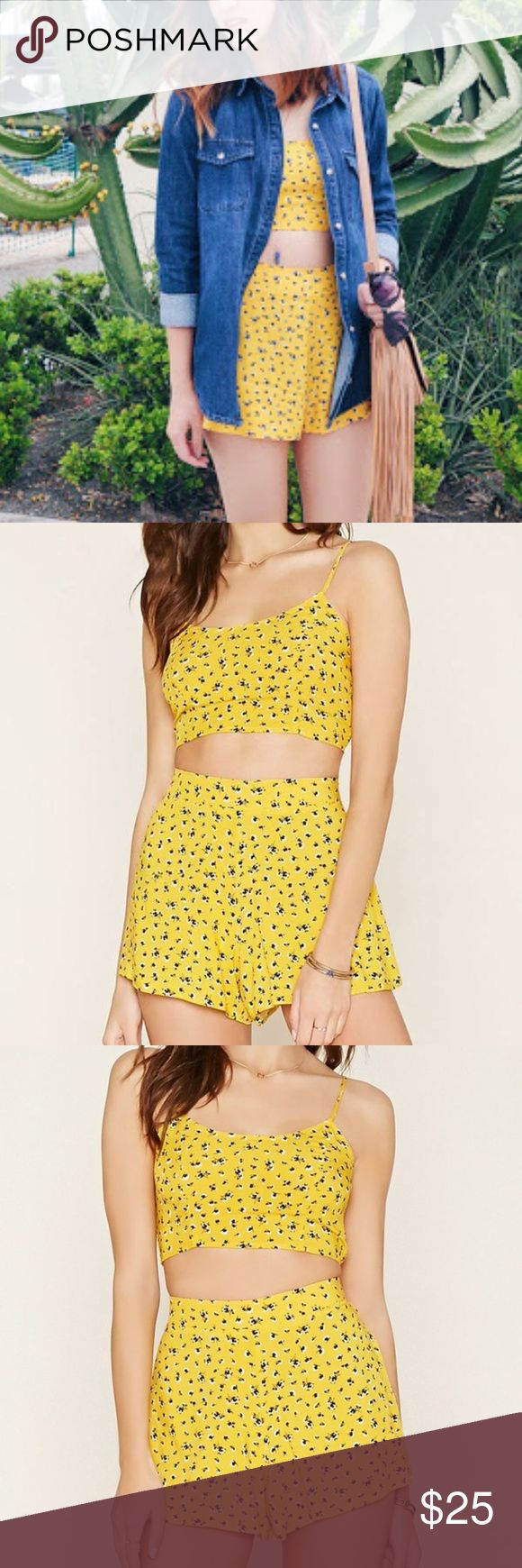 Forever 21 | Yellow Two Piece Top and Shorts Set Two-piece floral print cropped top and shorts set from Forever 21. This sweet little top and shorts co-ord set is perfect for spring/summer. This would make a great music festival outfit. Only worn once for photos. Straps are adjustable. Back of the top is a stretchy rushed elastic to ensure the perfect fit. Bottoms are also fitted with elastic on the back. Forever 21 Shorts