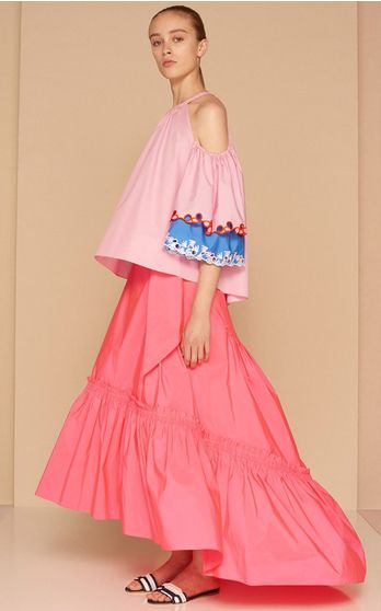 The Designers: Peter Pilotto and partner Christopher de Vos are known for their graphic prints.      This Season It's All About: Latin America. Bright pinks and blues channel a vacation feel while taffeta and lurex join signature cottons for an elevated take on the travel wardrobe.      The Piece to Buy: The gold lurex mini dress is a MUST.