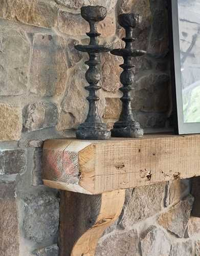 fireplace mantel made of reclaimed wood beam