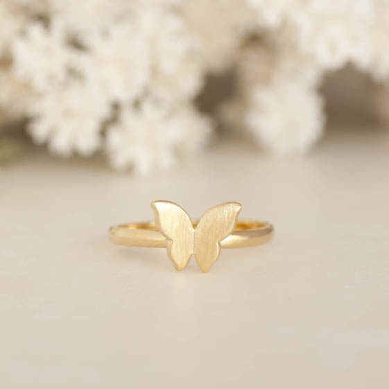 Pettite gold butterfly ring