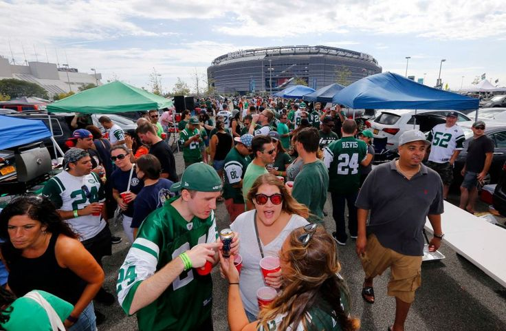 New York Jets fans gather in the parking lot before the opening day game against the Cincinnati Bengals at MetLife Stadium on Sunday, Sept. 11, 2016 in East Rutherford, New Jersey.