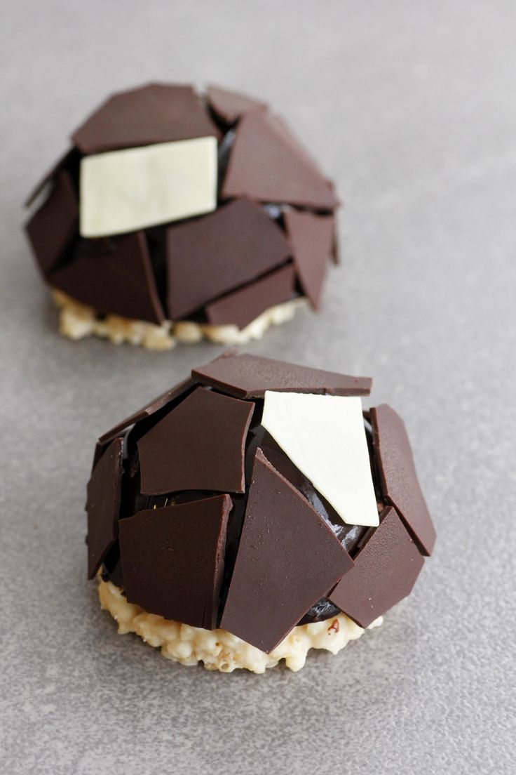 Chocolate and Salted caramel domes on a rice krispy base with chocolate shards