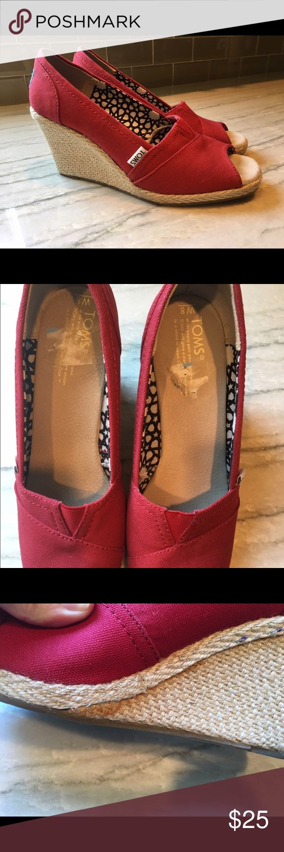 Red Toms espadrille peep toe wedges Worn twice! Red canvas Toms espadrille wedges. Price sticker on inside of foot bed (as pictured). On the inside of right shoe, looks like there is some glue overlap- see picture - not noticeable when wearing. Toms Shoes Wedges