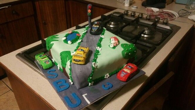 Cars cake - with plastic cars.