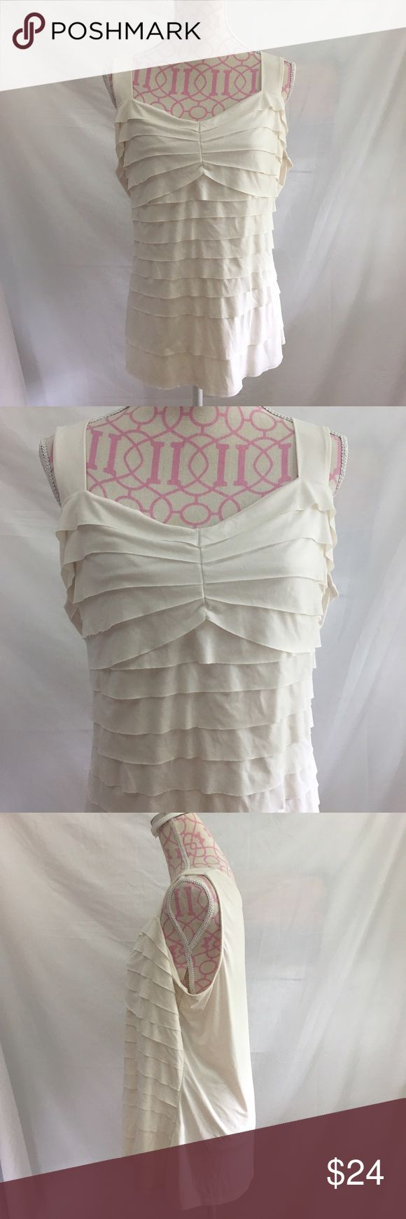Lane Bryant Tiered Top Size 18/20 Lane Bryant white tiered top. Sleeveless. Excellent condition  Size 18/20 Bust approximately 44 inches  Length approximately 25 inches 95% polyester/ 5% spandex Lane Bryant Tops Blouses