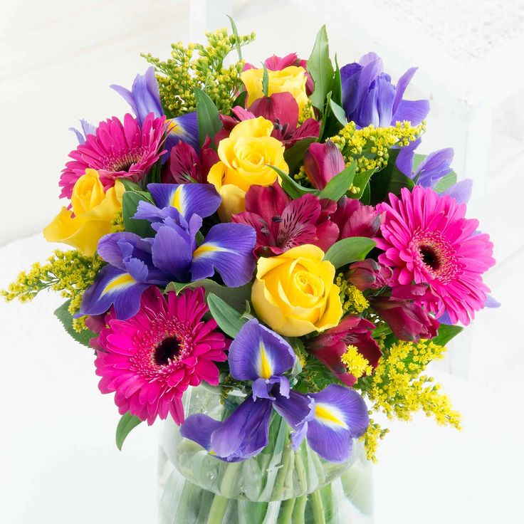 Vibrant Celebration - A beautifully bright and bold bouquet that will bring a splash of colour to their day.