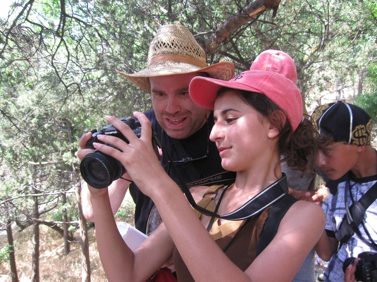 A student in Crimea shows her work to a National Geographic photographer, as part of Photo Camp Crimea in 2010.