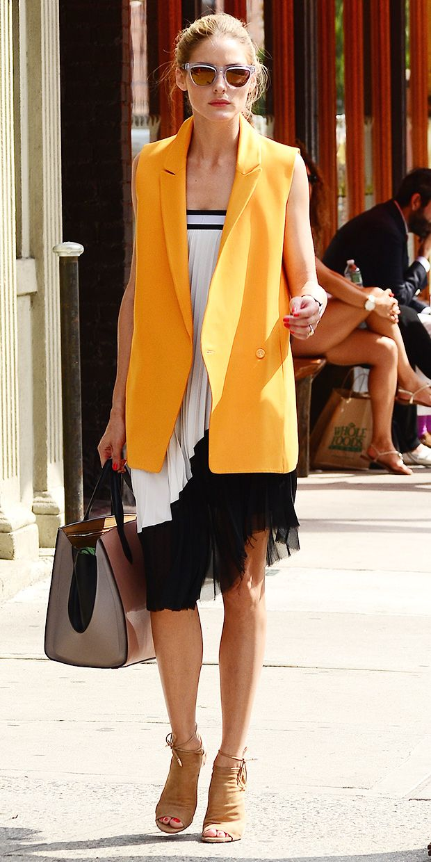 Olivia Palermo shows how to incorporate an oversized (orange) vest into your look. // #Fashion #Style   399      74      1