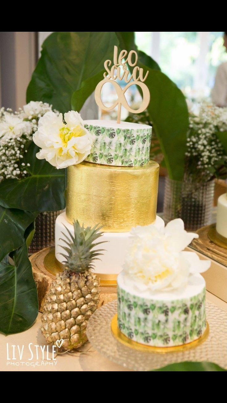 Taste the tropics with this gorgeous 3-tiered tropical themed wedding cake #wedding #cake #tropical #gold #fondant #stenciling
