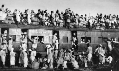 FILE - In this Sept. 19, 1947 file photo, Muslim refugees sit on the roof of an overcrowded train near New Delhi as they try to flee India. In the partition of the subcontinent into India and Pakistan after gaining independence from Britain in 1947, an estimated 1 million Hindus, Muslims and Sikhs were killed in rioting, and 12 million were uprooted from their homes. (AP Photo)