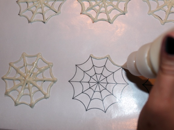 pipe webs onto wax paper and refrigerate......can also make tiaras, and lace doilies