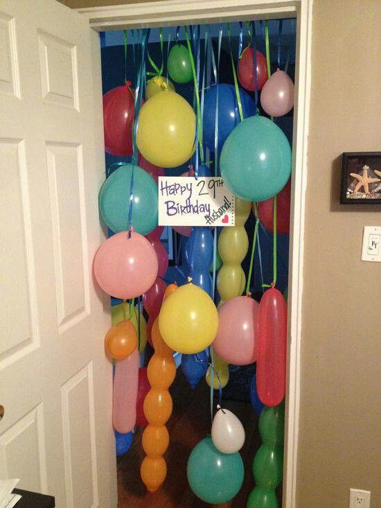 I like the different type of ballons. Mix that with the idea to put the ballons between plastic and the door so they coming flying in when he opens the door. Perfection.