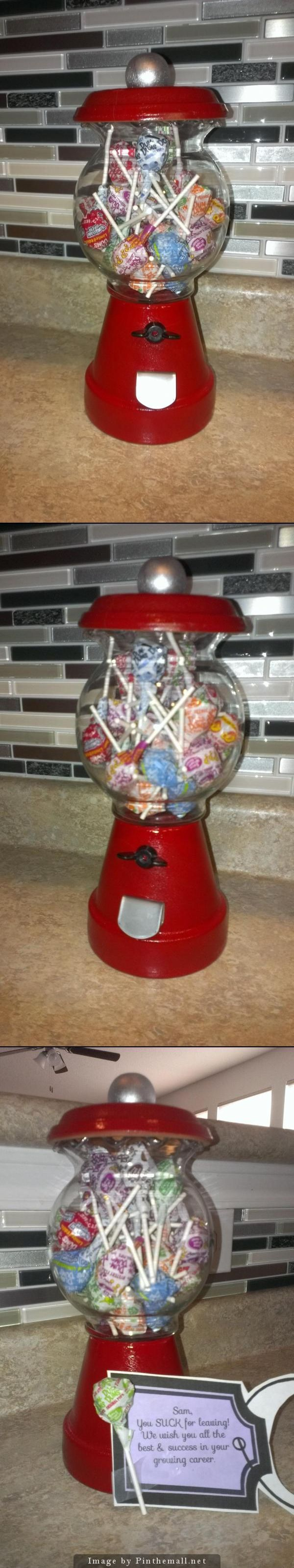 "DIY gumball machine/candy jar. Going Away gift for co-worker ""You SUCK for leaving!"" -flower pot, ""fish bowl"" from Michaels, wooden spool, wing nut & folded kids 'dog tag'. Under $5 to make. - created via http://pinthemall.net"