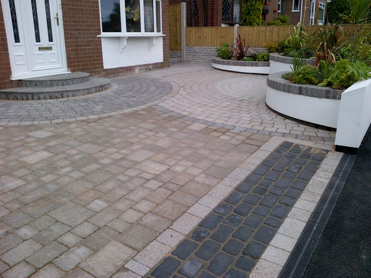Contemporary Driveway in Marshalls Argent & Tegula Setts with a Marshalls Drivesys Edge detail and Raised Beds