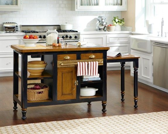 Bastille Kitchen Island   Williams-Sonoma Features a black granite inlet and removable cutting board & a slid-out side table for extra workspace.