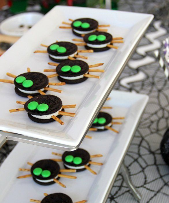 Stick pretzel sticks in the sides of double-stuffed Oreos. Then, use frosting to stick M on top of the Oreos for eyes. That's it! This is a great recipe for kids to help with—no hot or dangerous materials, and lots of margin for error.