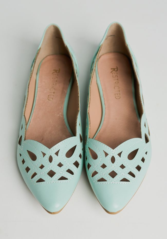 These adorable leather flats are crafted in a gorgeous mint hue with white stitch details and an intricate laser cut design.