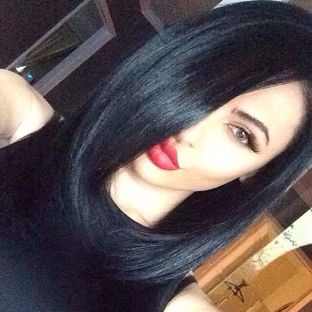 black hair and red lips short hair , makeup.