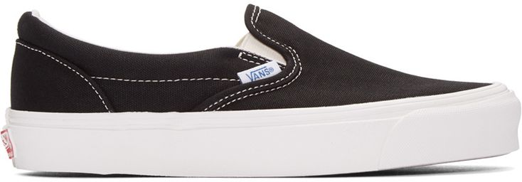 Canvas slip-on sneakers in black. Round toe. Elasticized gusset in off-white at sides of tongue. Logo flag in white a outer side. Padded collar. Textured rubber midsole in white featuring logo in red at heel. Rubber sole in brown. Contrast stitching in white.  Part of the Vault by Vans collection.