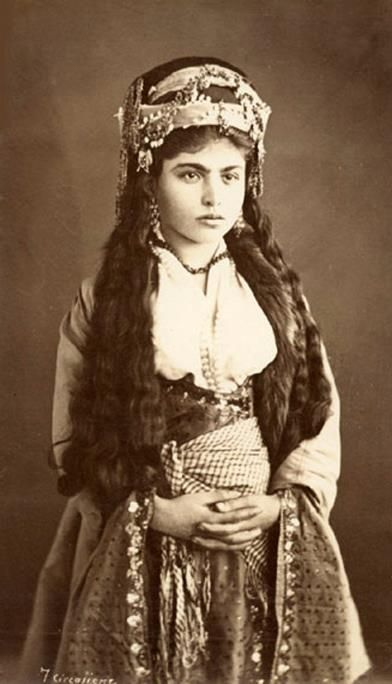Lebanese girl in bridal/festive costume. Ca. 1875.