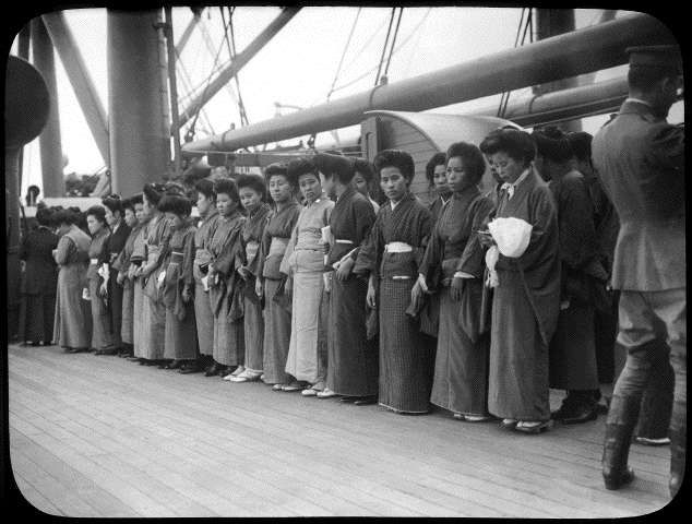 Group of Japanese women standing in a line on an immigration ship to America circa 1925. Photo Source: California State Parks, State Museum Resource Center.