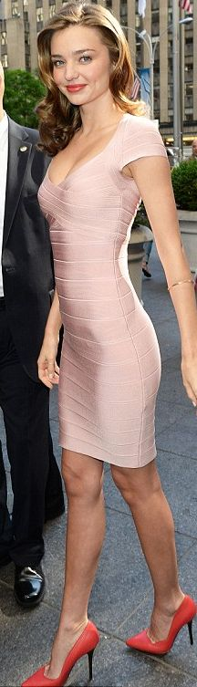 Who made  Miranda Kerr's cap sleeve pink dress and red pumps that she wore in New York on June 4, 2013?