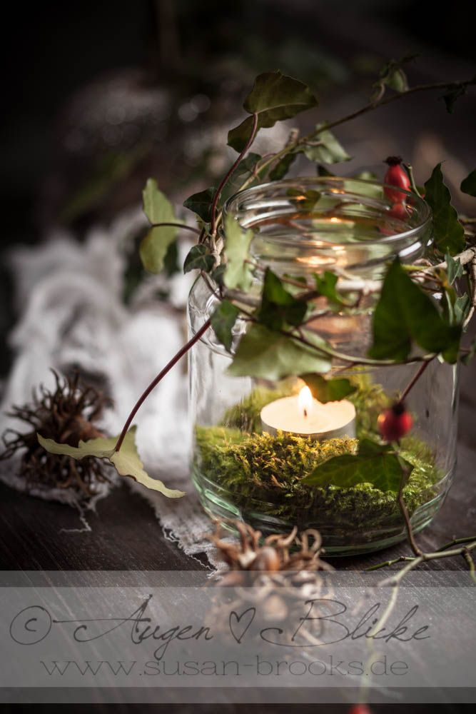 Autumn-Decoration. This looks simple and pretty. I have a big supply of moss in my yard, as well as little jars and candles in the house.. I've also been eyeing the holly for its red berries. HM.
