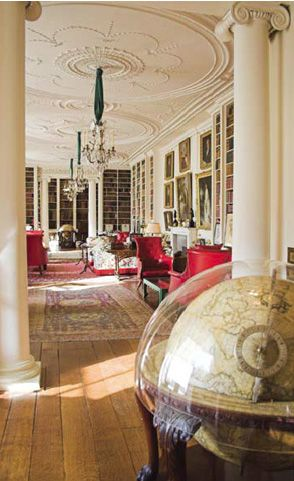 This is the library/sitting room at Althorp, the ancestral English home of the Spencer family, and the childhood home of Diana, Princess of Wales. This is a grand yet lovely space, with its traditional English Country furnishings. The white bookcases, walls, ornate ceiling and columns all serve to keep the room from looking too heavy, yet there is room to store the 10,000 or so books